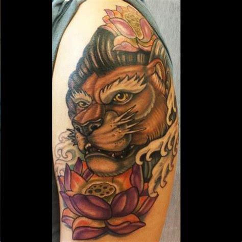 lotus tattoo with lion dark water tattoos
