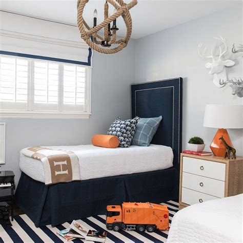 twin beds boy s room tufted headboards kids rooms blue and orange kid s room boasts pale blue walls lined