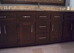 brown painted cabinets on brown cabinets