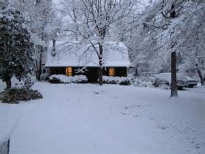 snow covered log cabin by beachfamilyedre photo