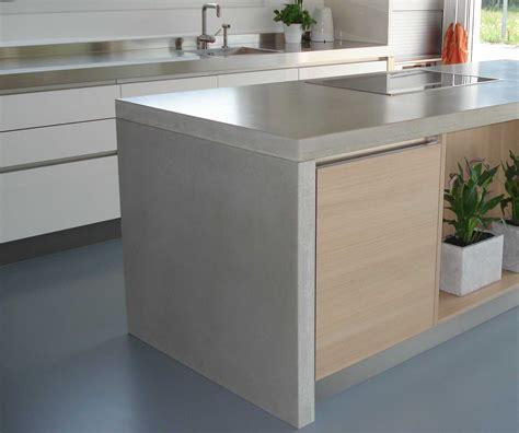 white cabinet  chrome long handles  stainless steel gas range  concrete floors