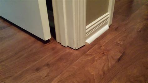 best way to cut laminate flooring around door frames