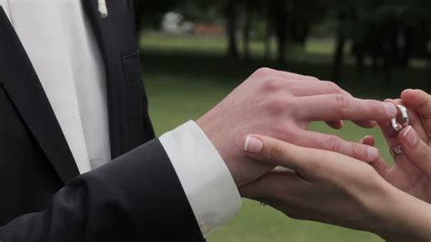 bride putting wedding ring on stock footage video 100