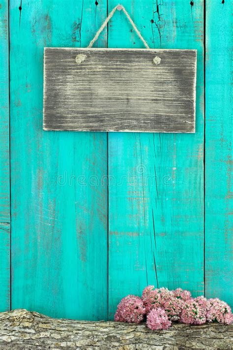 blank rustic sign hanging  antique teal blue wood fence