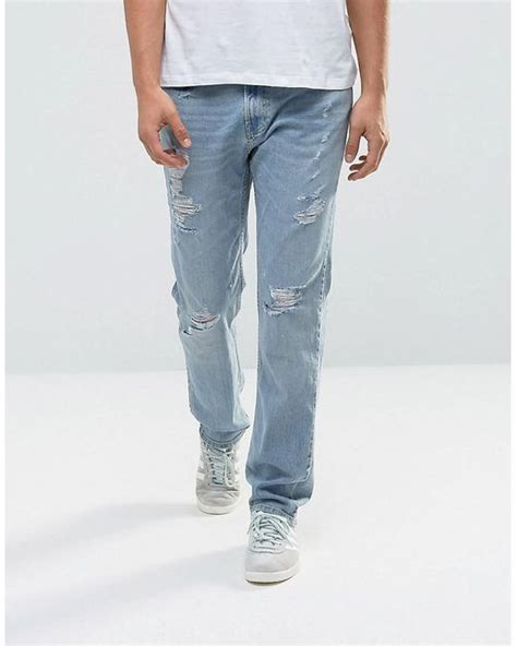 light wash jeans mens lyst hollister jeans slim fit destroyed light wash in