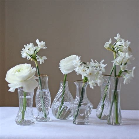 clear glass and gold wedding centrepiece tray with 6 vases