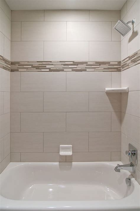 bathtub tile designs might have the tiles vertical rather than horizontal for