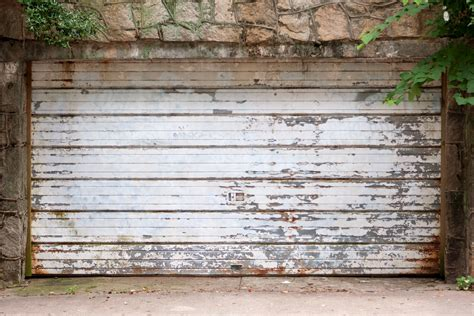 repair vs replacement options for garage doors
