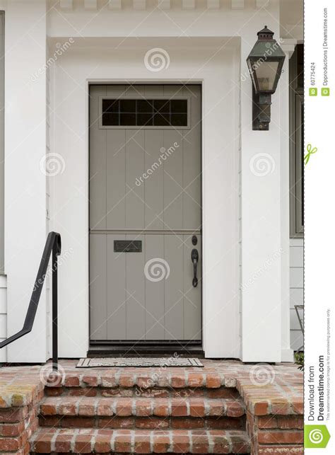 Front Door With White Exterior And A Large Porch Light Small Exterior Door