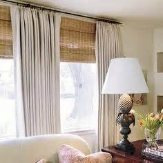 drapes over woven roman shades for the home pinterest 1000 images about window treatment woven shades on
