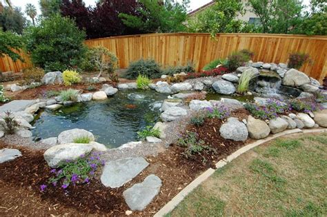 backyard pond building building a koi pond or garden pond how to take care of