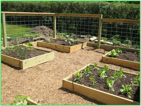 building a raised bed garden building a raised garden bed against a fence the best