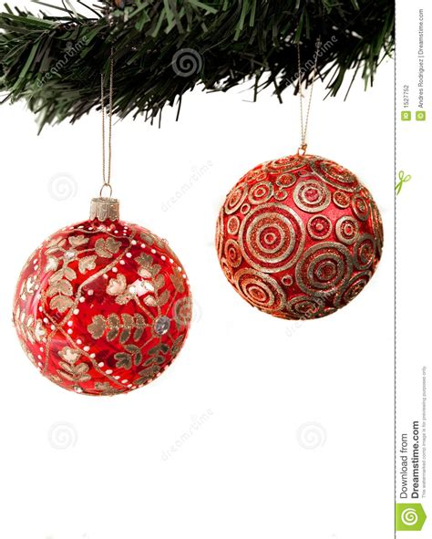 christmas balls hanging from a xmas tree stock photo