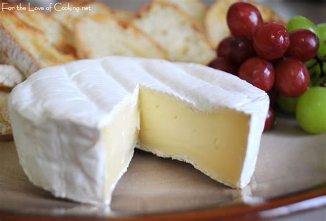 brie served with crostini and grapes