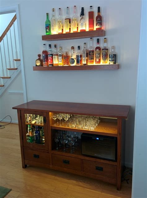 he turned an media cabinet into an awesome diy bar