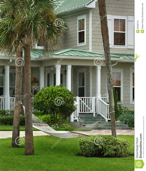 grey house grey house with green roof stock photo image 38008770