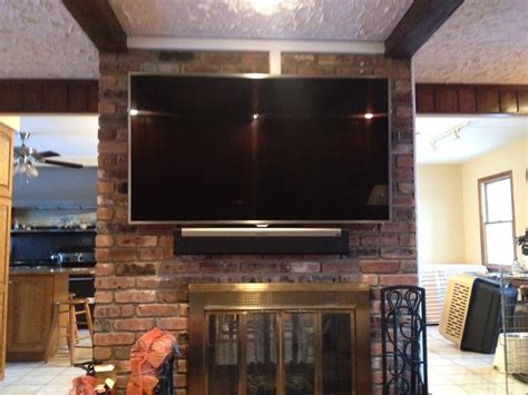 mount tv brick fireplace tv mounted all brick fireplace wires concealed sonos