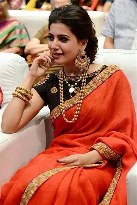 Orange Designer saree with black blouse   Photo Gallery