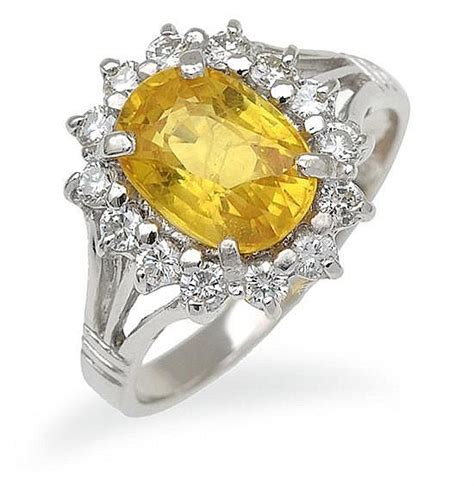 yellow sapphire and cluster ring centrally set