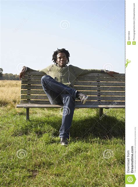 sitting on a park bench song man listening to music on park bench stock images image