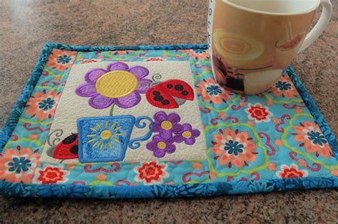 Patchwork Mug Rugs - patchwork quilted and embroidered mug rug by stephsquilts