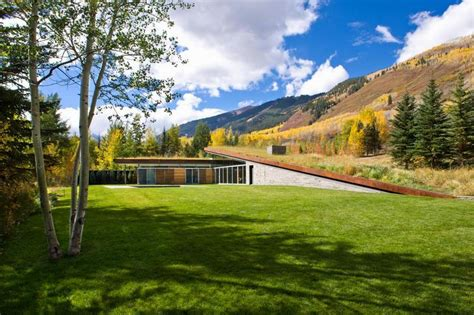 House In The Mountains modern house with roof that integrated into the mountains