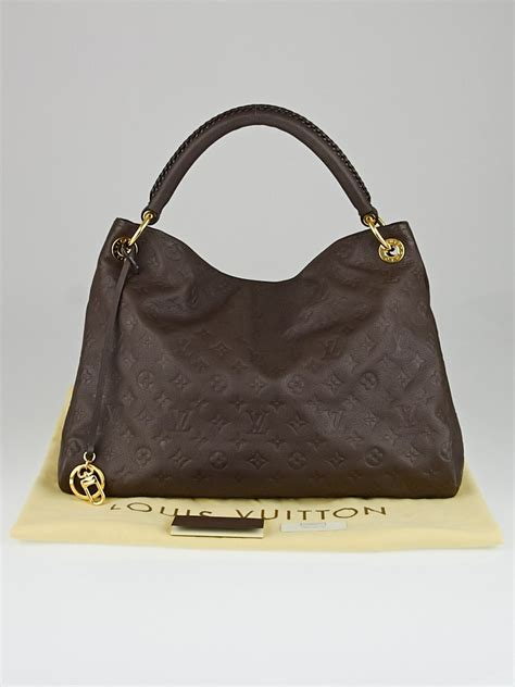 louis vuitton terre monogram empreinte leather artsy mm