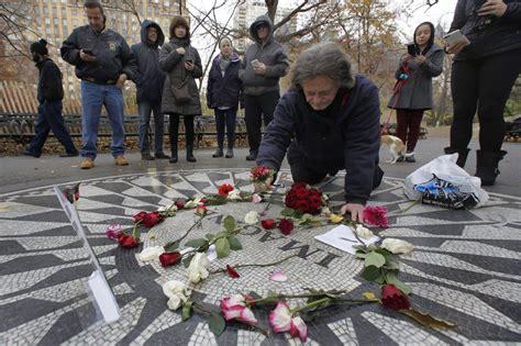 John Lennon fans offer peaceful tributes to slain Beatle