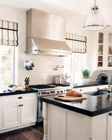 Magnetic Kitchen Faucet black kitchen cabinets with white countertops