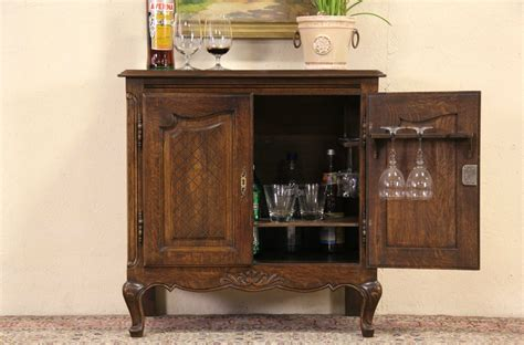 sold country 1920 s carved oak bar cabinet harp