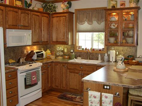 Country Kitchen Cabinet The Oak Drawer Pulls Door Knobs And Molding On Top Of Cabinets Countertop And Backsplash