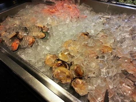 varieties of fresh seafood on ice bed picture of union
