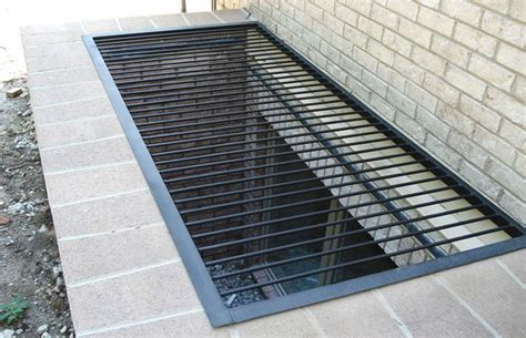 metal grate window well covers window guard fabricator installer custom window guards