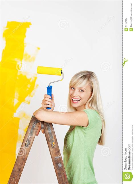 house painter painting www pixshark com images happy woman painting on ladder stock images image 31187024