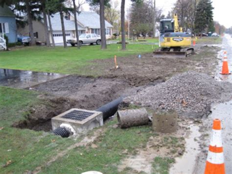 catch basin in backyard buckeye trenching serving akron canton and all of northeast ohio summit county