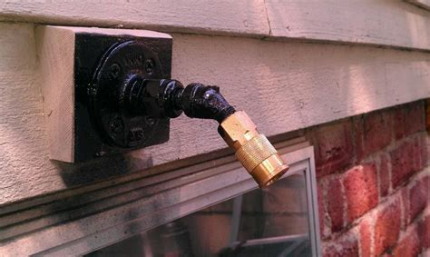 compressed air bulkhead fitting outside wall of house