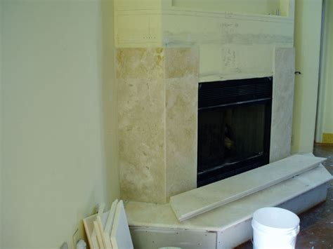 Install Fireplace Surround by Installing A Marble Travertine Granite Or Slate