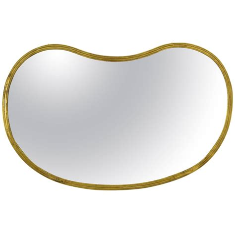 kidney shape kidney shape brass mirror