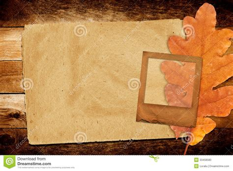 old grunge paper slide with autumn oak leaves stock photo