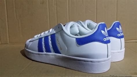 adidas superstar sneakers white blue stripes