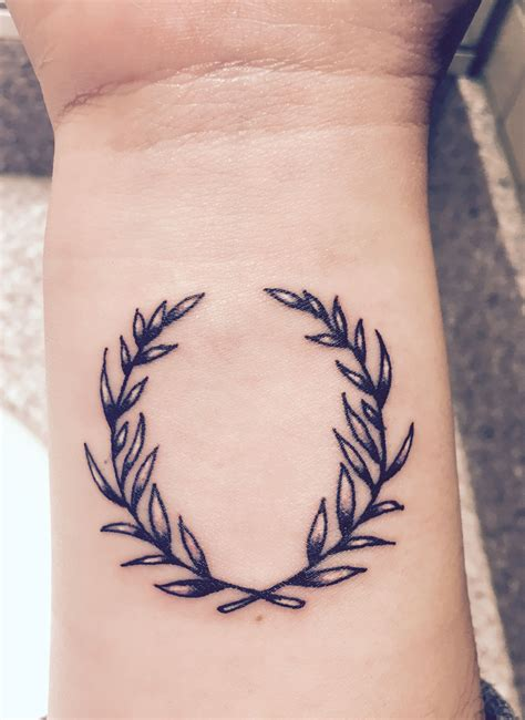 victory tattoo olive wreath inner wrist meanings peace growth