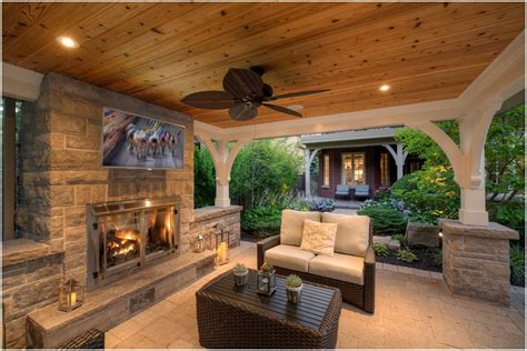 fireplace in backyard outdoor stone fireplaces lanterns outdoor tv pavilion