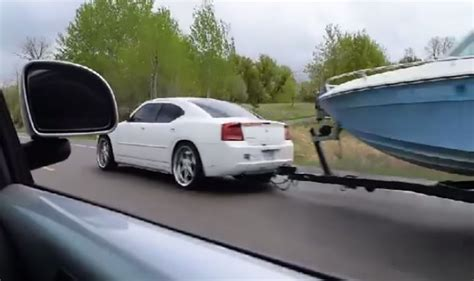 cummins charger rollin coal diesel swapped dodge charger towing a boat while rolling coal
