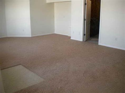 laying carpet in basement basement how to install carpet tiles for basement