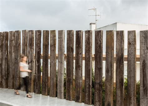 Railway Sleepers Fence by Home Incorporates Materials Like Cork And Railway
