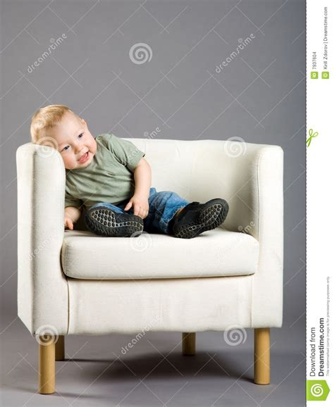 Boys Armchair boy in armchair stock images image 7937604