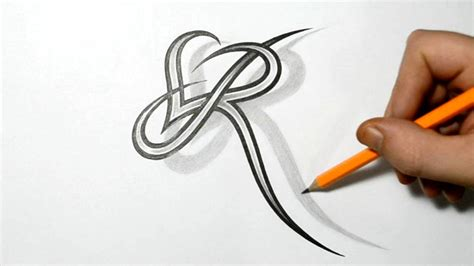 tattoo of alphabet r letter r and heart combined tattoo design ideas for