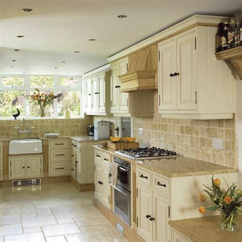 neutral kitchen with travertine floor traditional painted oak kitchen kitchen design