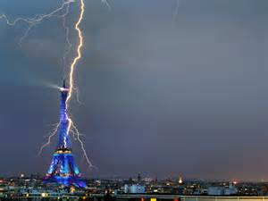 Awesome Lighting awesome photograph lightning bolt appearing to strike the eiffel tower