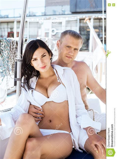 women on boats handsome man and a beautiful and woman on a sailing boat